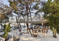 Dine in a luxe treehouse overlooking the Aegean