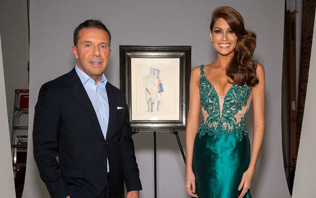 Picasso's grandson Olivier poses with Miss Universe 2013 Gabriela Isler beside 'The Man With Opera Hat'