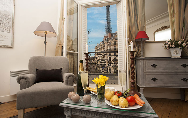 Volnay combines unobstructed views of the Eiffel Tower via five sets of French doors with Parisian decoration