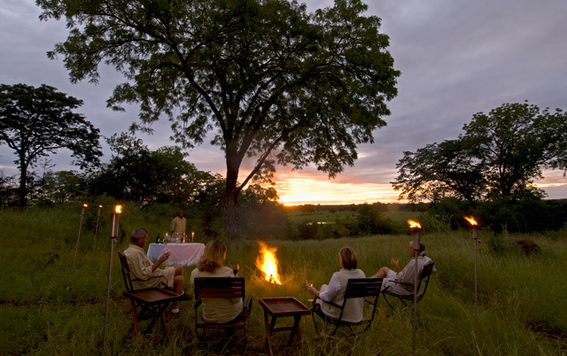 Sunset drinks at Sanctuary Chichele presidential lodge in Zambia