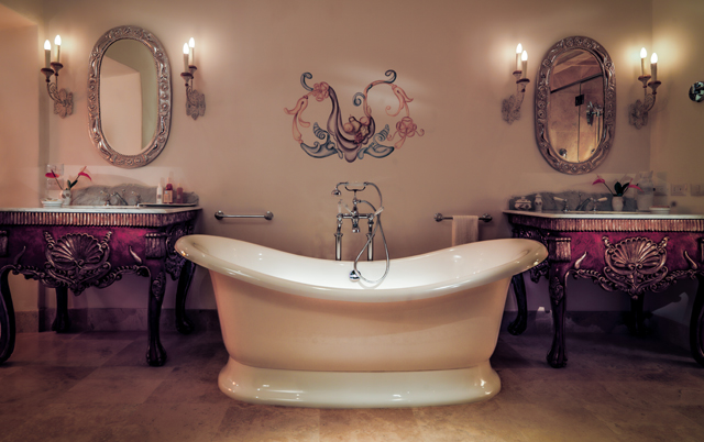 Each room has a sizeable, marble-clad bathroom with freestanding bath